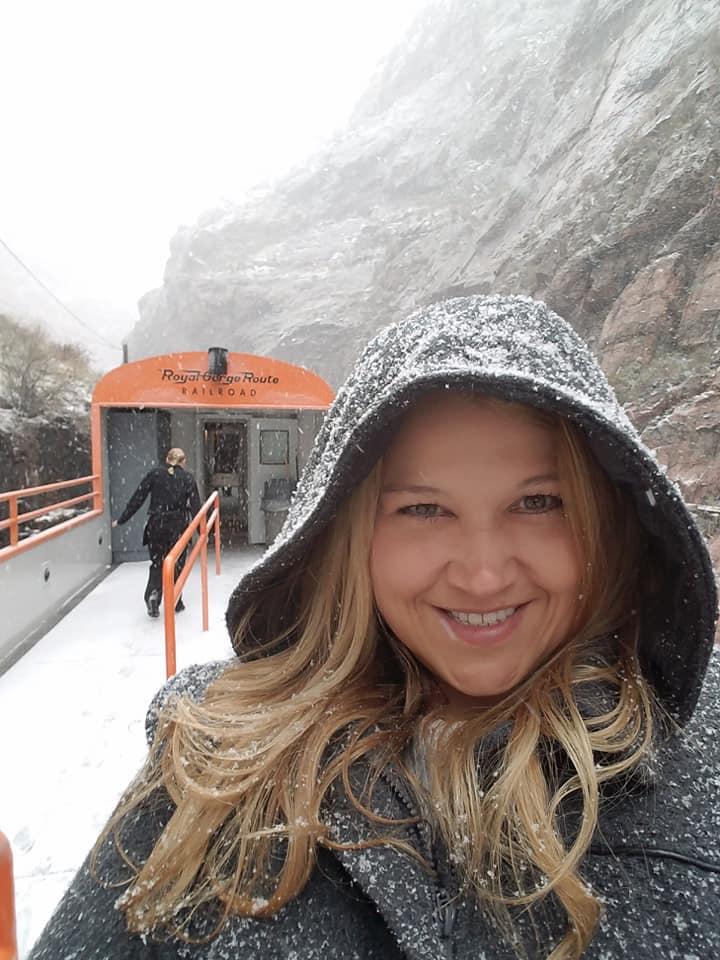 Lara Coffer riding a snowy train through Royal Gorge